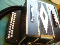 Beautiful Serenellini Deluxe Edition 233 B/C 3 stopper black and white button accordion.