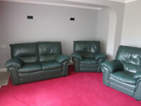 FREE - Three Piece Suite, in green leather.