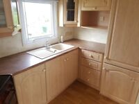 Static caravan for sale with heating and double glazing/2.3k site fees/lakes/golf/entertainment/pets