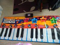 Gigantic keyboard playmat
