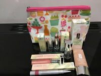 CLINIQUE MAKE ALL NEW AND UNUSED. MAKE UP BAG NOT NEW JUST TO KEEP MAKE UP CLEAN.