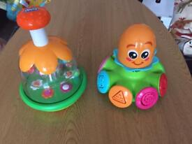 Chicco and Tomy spinning toys