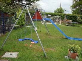 Swings and Slide with raised play area and Fireman's Pole.