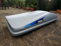 Thule Evolution Roof Box + Halfords Roof Bars. Good condition. Hardly used. Buyer collects.