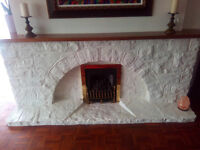Stone fireplace. Painted purbect stone. to be removed shortly.