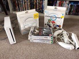 Nintendo Wii with 2 Controllers 5 Games and 2 Wii Wheels