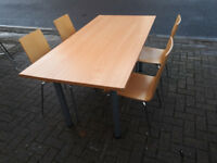light brown wood office desk/table with 4 wood chairs