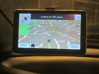 """Sat Nav with 7"""" touch screen with calculator, unit convert, FM radio, Games & much more."""