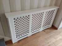 MDF Radiator cover with removable front panel, painted white.
