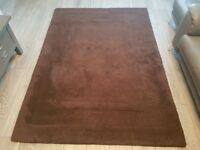 100% wool chocolate colour rug.
