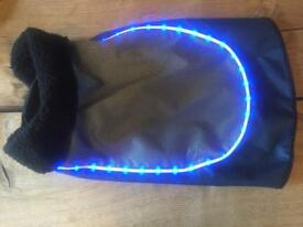 Waterproof fleece lined dog coat with reflector strip and on/off lights for dusky walks