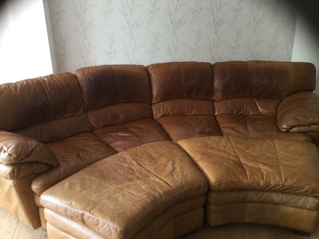 Curved Distressed Tan Leather Sofa Plus 2 Matching Pouffes