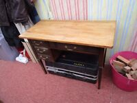 SOLID PINE TOPPED DESK WITH 2 DRAWERS. 1 IS DEEP FOR FILES ETC. OR MAYBE A DRESSING TABLE