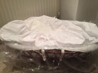 Moses basket with broderie anglaise cover and full rocking stand