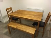 Solid oak dining room table with bench and 2 chairs