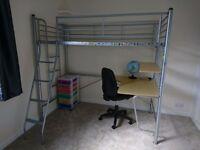 Metal frame high sleeper bed with desk underneath