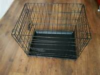 Medium sized dog cage will plastic pull out tray
