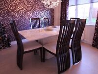 Marble dining room table and 6 Mahogany coloured chairs.