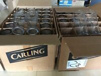 120 used carling pint glasses