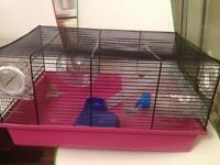 Good condition hamster cage with accessories for sale