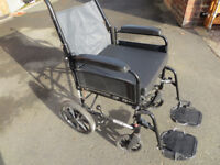 Wheel chair with foot rests, removable cushion/pad, folds up.