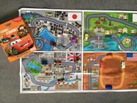 Selection of toy cars, electronic dinosaur and a Disney cars book