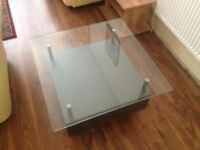 silver coffee table with glass top