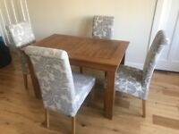 Solid Oak dining table and 4 dining chairs