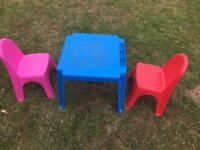 Child's plastic table and chairs plus new play sand