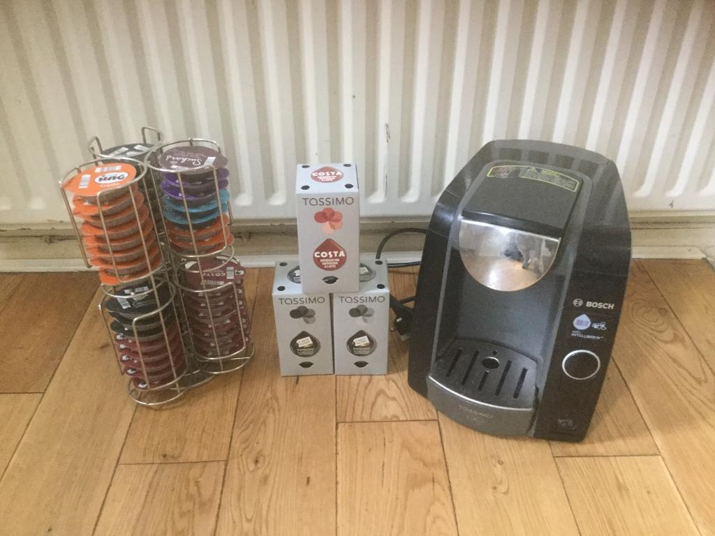 Bosch Tassimo TAS4302GB Coffee Machine & Metal stand with over 50 capsules