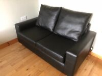 Two leather double sofa beds in black.