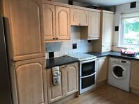 Fitted kitchen with gas cooker, sink and worktops