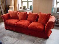 Large Red Luxious Sofa - Sits four people - Little use