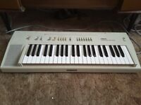 Retro Yamaha 80s electric keyboard