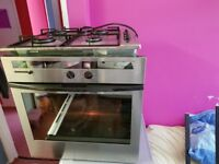 Fitted intergrated BOSCH oven and 4 burner gas hob. Was £800. Now only £100. Delivery. Clean