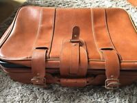 older style suitcase and matching cabin bag