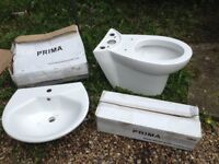 A new Prima toilet and bathroom sink - 7522