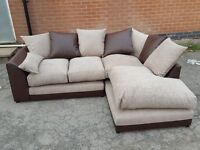 Comfy BRAND NEW corner sofa.Brown leather base & beige fabric cushions.BRAND NEW. can deliver