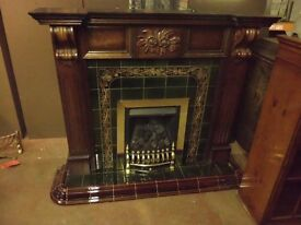 FIREPLACE WITH WOOD FIRE SURROUND AND TILED INSET
