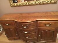 Immaculate oak side board with matching dining table for sale.