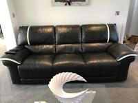 Black and white leather couches (3 seater, 2 seater and chair)