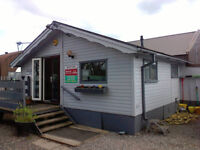 Lodge twin unit 34 x 20 wood clad exterior, double glazed, central heating 3 bedrooms