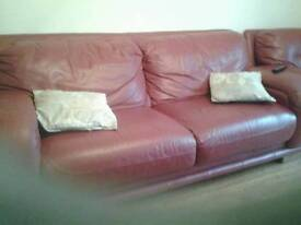red leather 3 seater 1chair and 1 black recliner cheap for quick sale