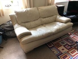 Leather sofa in cream. Good condition; well looked after.