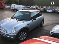2003 Mini Cooper in silver with black roof. Full service low mileage 79k and two sets of keys.