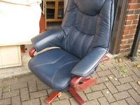 Good quality blue leather chair and foot stool.