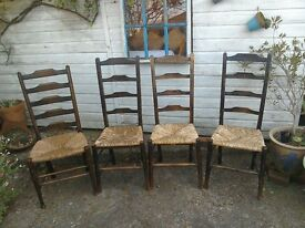 4 ladder back chairs plus carver for sale