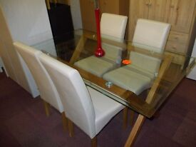 New oakington glass dining table + 4 cream skirted chairs