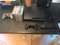 PS3 console, controllers and gamsa