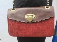 Brown leather and red velvet small bag